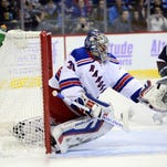 Rangers goalie Henrik Lundqvist makes a glove save in the second period against the Colorado Avalanche at Pepsi Center Friday night.