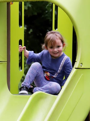 """Ava Webster, 3, plays on the slide in the children's area at Fort Smith Park, Friday, July 31, 2020, during a visit with her grandmother, Maggie Schmitz, her little sister, Liza Jane, 1, and her mother, Morgan Webster. According to Shari Cooper, Fort Smith PR & Communications Manager, the City of Fort Smith encourages everyone to get out and enjoy its park system but take notice of the park signage reminding visitors to socially distance (""""Do Your Part -- 6 Feet Apart""""). However, Cooper says that the City of Fort Smith follows the Governor's directives, as well as the Arkansas Department of Health's and Centers for Disease Control and Prevention's guidelines. In doing so, at this time, the City specifically prohibits playground usage until further notice. Cooper said that the park staff does not have the resources to sanitize all of the playground equipment across the city and the City is not liable if individuals violate the policy, and so playground usage is completely at the individual's own risk."""