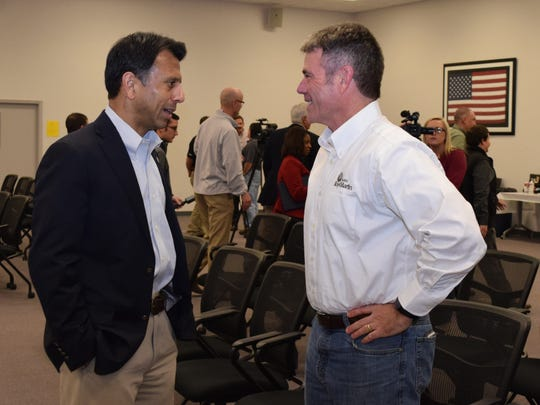 Gov. Bobby Jindal (left) talks with Roy O. Martin III, president and chief financial officer of RoyOMartin, after a press conference Tuesday at Crest Industries in Pineville. Jindal toured Crest Industries and hosted a business roundtable.