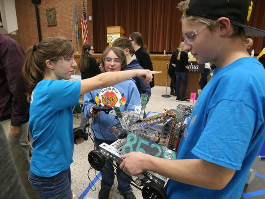 The Rhyme Know Reason team, comprised of home-schooled students, including (from left) Katie Petrucci, 15, of Wilmington, Ben Rehrman, 13, of West Grove, Pa. and Skylar Slaten, 14, of Elsmere, get their robot set for competition during a First Tech Challenge meet at Padua Academy Nov. 14, 2017.
