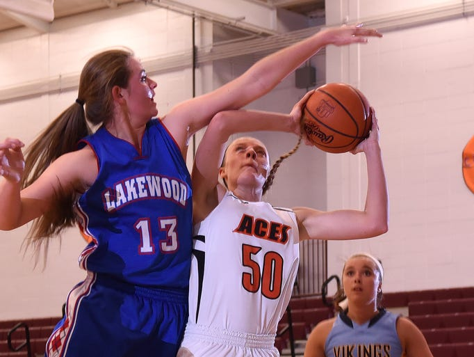 Lakewood's Courtney Vierstra tries to block a shot