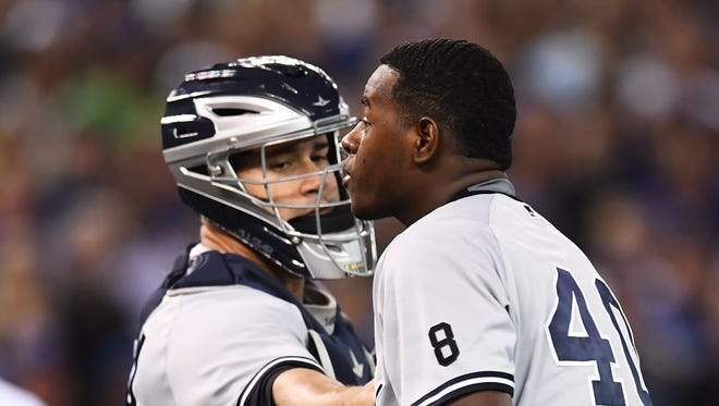 New York Yankees pitcher Luis Severino approachesToronto Blue Jays' Justin Smoak after hitting him with a pitch during the second inning of a baseball game Monday, Sept. 26, 2016, in Toronto.