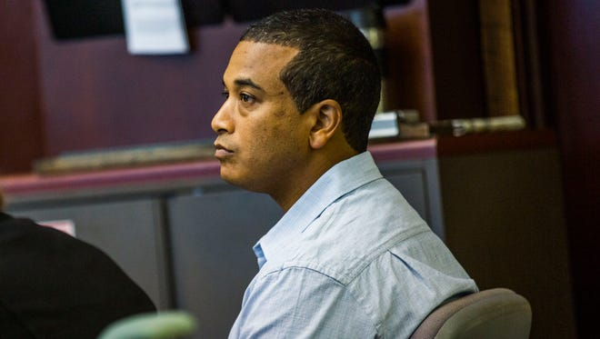 Rene Miles listens during the first day of his trial at the Collier County Courthouse on June 13, 2017.