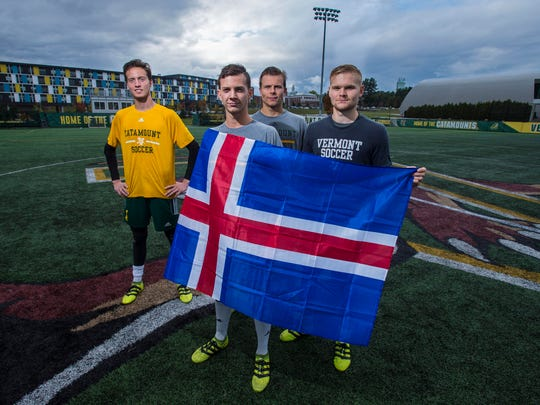 University of Vermont men's soccer players and natives of Iceland, from left, Aron Runarsson, Jon Arnar Barddel, Arnar Steinn Hansson and Loftur Eriksson pose with the Icelandic flag at Virtue Field in Burlington on Monday, October 3, 2016.