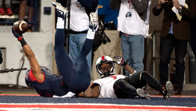 Nov. 14, 2015; Tucson; Arizona Wildcats wide receiver Nate Phillips scores a touchdown against the Utah Utes during the second overtime at Arizona Stadium. Arizona won 37-30 in double overtime.