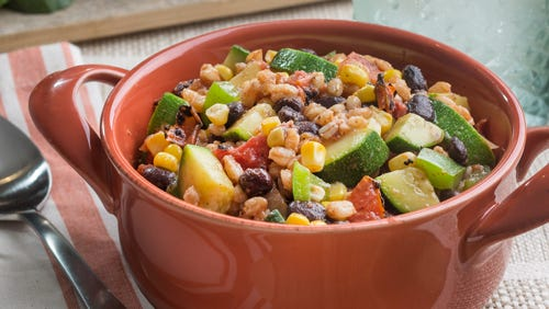 Farro joins tomatoes, zucchini, black beans and more in this vegetarian main dish.