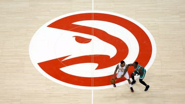 Hawks GM Wes Wilcox apologizes after fan insulted by racial joke
