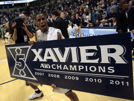 Dante Jackson celebrates the Musketeers winning the Season A10 Championship for the 5th year in a row on Wednesday, March 2, 2011, over Charlotte 68 to 48 at the Cintas Center.
