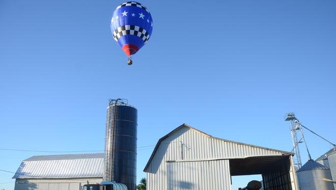 Joe Heartsill of San Angelo, Texas flies above a farm on D Drive North during a practice flight Wednesday.