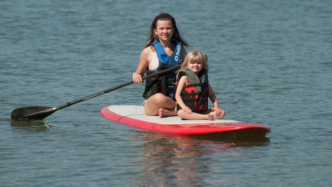 Bella Mays and Juliette Beavers enjoy a day on Old Hickory Lake in Henderson ville in May.