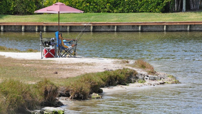 Ballard Park, where the Eau Gallie River empties into the Indian River, is a popular fishing spot. Officials plan a $20 million dredging project in the river to remove muck. But first, they must build a muck storage area at Sarno Road landfill.