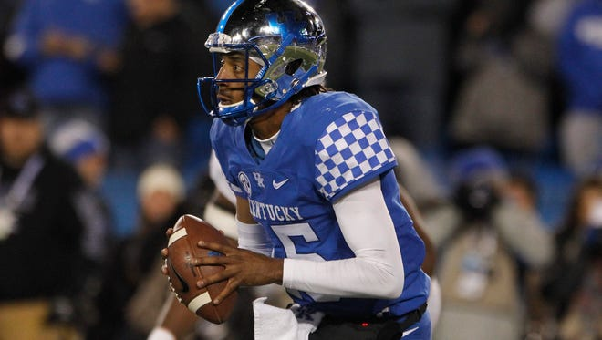 Oct 28, 2017; Lexington, KY, USA; Kentucky Wildcats quarterback Stephen Johnson (15) runs with the ball against the Tennessee Volunteers In the second half at Commonwealth Stadium. The Wildcats won 29-26. Mandatory Credit: Mark Zerof-USA TODAY Sports