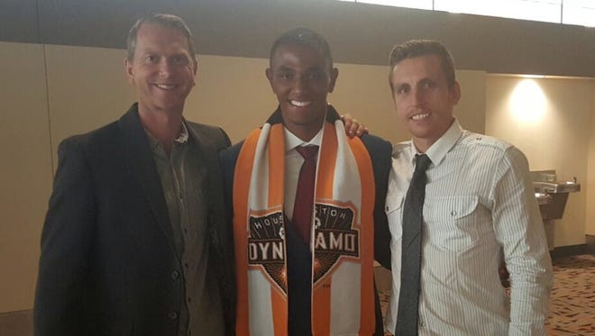 Eastern Florida men's soccer coach Oliver Twelvetrees poses with Ivan  Magalhaes and assistant coach Josh Schirmer.