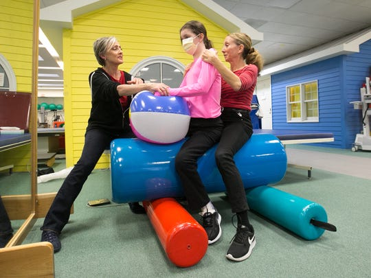 Heart transplant recipient Rebecca Conroy, 12, center works with physical therapist Mara Abrams, left, and occupational therapist Sheri Coward, right, at Blythedale Children's Hospital in Valhalla on Thursday, February 22, 2018.