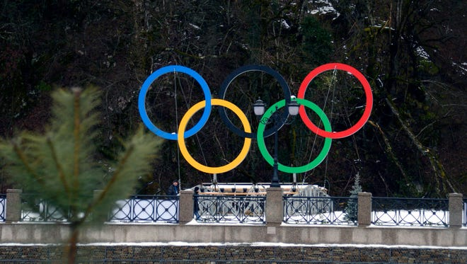 A view of the Olympic rings along the roadway running through the Rosa Khutor area of the mountain cluster of the Sochi Games.