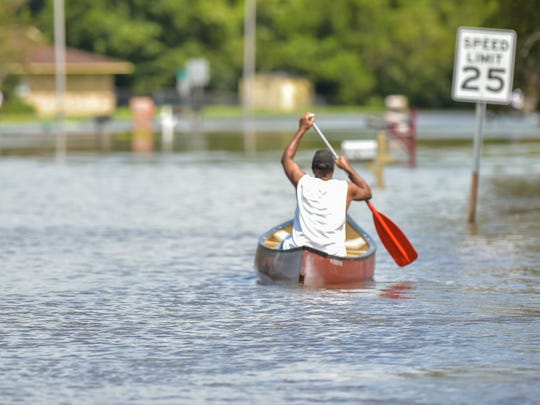 Residents on Carmel drive are rescued from flood waters