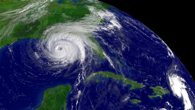 Hurricane Ivan and Tropical Storm Jeanne, bottom right, are seen in this satellite image taken at 10:45 a.m. EDT on Sept. 15, 2004.