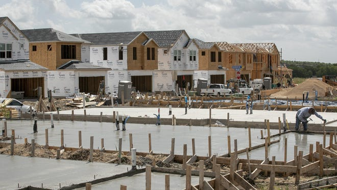 New homes are under construction in the Easton Park subdivision in Austin. From April through June, builders started work on 5,330 houses in the Austin metro area, a record for the second quarter.