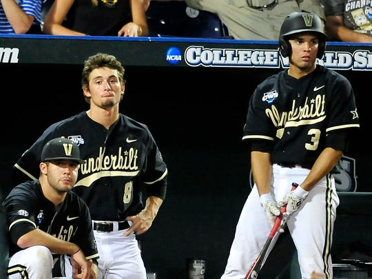 L to R, Vanderbilt players Chris Harvey, Rhett Wiseman and Vince Conde watch the game against Virginia during the 7th inning at the College World Series at TD Ameritrade Park in Omaha, Neb., Tuesday, June 24, 2014.