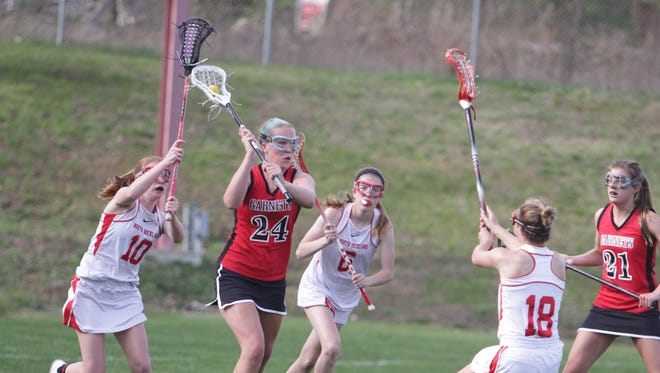 Action during a Section 1 girls lacrosse game between North Rockland and Rye at North Rockland High School on Monday, April 18th, 2016. North Rockland won 10-5.