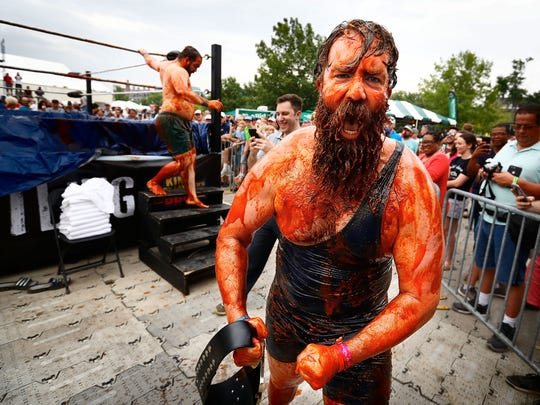 Matt Butler reacts after winning his bout during sauce wrestling at the 2018 Memphis in May World Championship Barbecue Cooking Contest at Tom Lee Park. This year's Barbecue Contest is set for May 15-18.