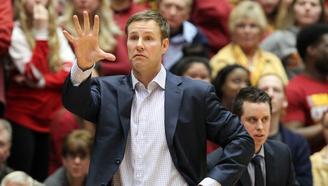 Iowa State Cyclones head coach Fred Hoiberg sets the teams offense against the Oklahoma Sooners at James H. Hilton Coliseum.