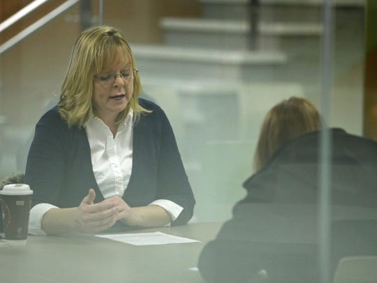 Attorney Michelle Angell meets with a client during a free legal clinic on Saturday at Fox Valley Technical College. The clinic is organized by the school's Paralegal Student Organization, which partners with local attorneys.