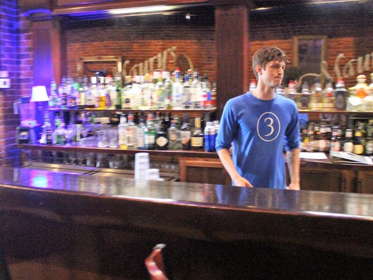 Joel Roberts, a bartender at Tres, waits for customers