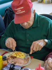 Longtime Goodfellow Tony Ferrante digs into breakfast.