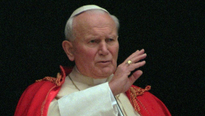 Pope John Paul II blesses faithful in St. Peter's Square in 1995.