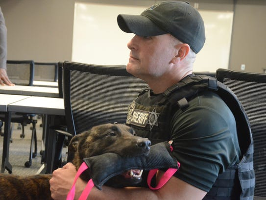 Deputy Guy Picketts with Rocket and her toy Thursday,