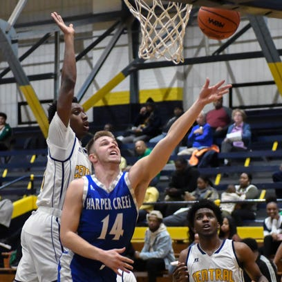 Harper Creek's Jon Taylor (14) goes for a layup during