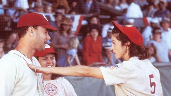 """Madonna, right, Rosie O'Donnell and Tom Hanks in a scene from """"A League of Their Own.'"""""""