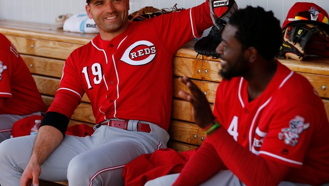 Cincinnati Reds first baseman Joey Votto (19), left, and Cincinnati Reds second baseman Brandon Phillips (4) share a laugh in the dugout during the Cactus League game between the Cleveland Indians and Cincinnati Reds, Thursday, March 3, 2016, at Goodyear Ballpark, in Goodyear, Arizona. The Reds defeated the Indians 9-1.
