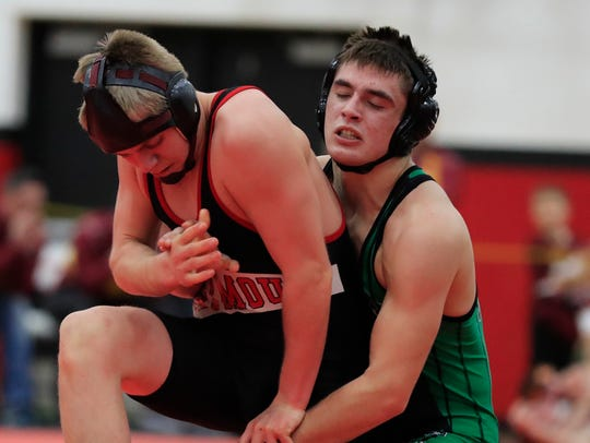 Coleman's Bryce Karban wrestles Seymour's Thomas Peters
