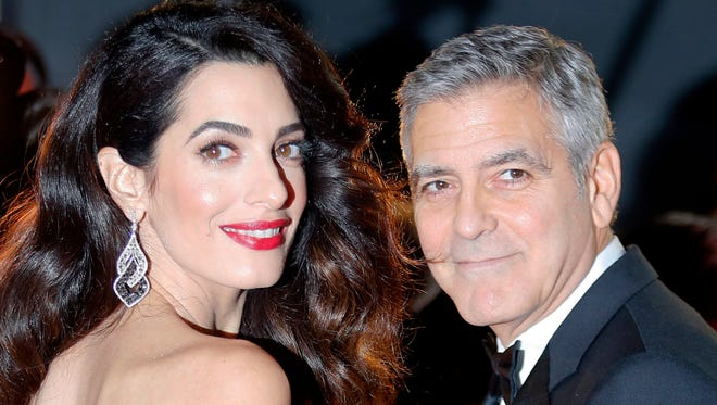 George and Amal Clooney on Feb. 24, 2017 at the Cesar Film Awards in Paris.
