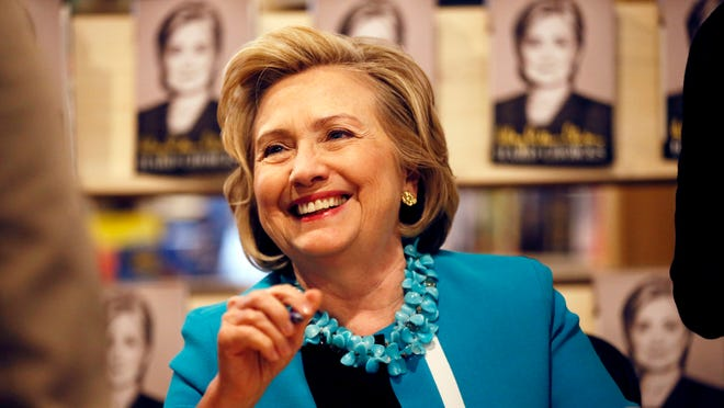 """Hillary Rodham Clinton signs copies of her new book """"Hard Choices"""" at the Common Good Books store, Sunday July 20, 2014 in St Paul, Minn."""