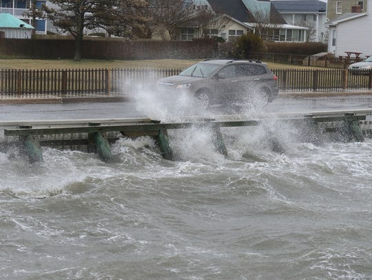 Waves from the bay in Ocean City crash onto Edgewater