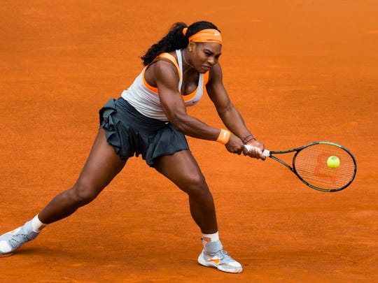 Serena Williams from U.S. returns the ball during her Madrid Open tennis tournament match against Petra Kvitova from Czech Republic in Madrid, Spain, Friday, May 8, 2015.