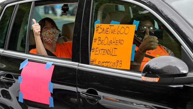 Motorists take part in a caravan protest in front of Senator John Kennedy's office at the Hale Boggs Federal Building asking for the extension of the $600 in unemployment benefits to people out of work because of the coronavirus in New Orleans, La. Wednesday, July 22, 2020.