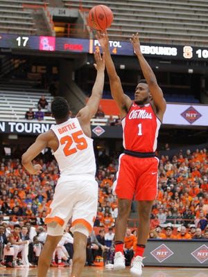 Mississippi's Deandre Burnett, right, shoots over Syracuse's Tyus Battle, left, in the first half of an NCAA college basketball NIT game in Syracuse on March 18, 2017.