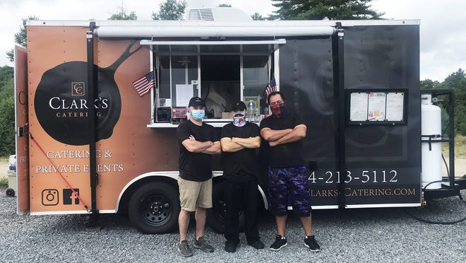 The cooking staff at the Clark's Catering food truck stationed at Muckey's Liquors in Lakeville, from left, Nevin Barton, Brent Clark and Joshua Hamblin.