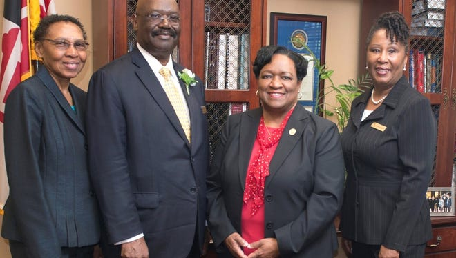 This submitted photo is of Bennie Smith Funeral Homes owners and operators Bennie Smith and his wife, Shirley (far left), along with University of Maryland Eastern Shore President Juliette Bell (third from left) and Cynthia Williams, a funeral home administrative assistant. The Smiths and their business have awarded UMES $100,000 that  establishes an endowed scholarship fund to financially aid deserving UMES undergraduate students.