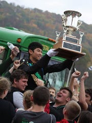 Members of Vestal Marching band celebrate after winning the New York State Field Band Conference Championship.