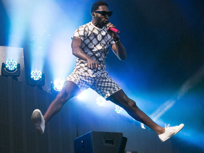 British rapper Tinie Tempah jumps as he performs on stage during V Festival 2014 at Hylands Park in Chelmsford, Essex, England, Sunday, Aug. 17, 2014. (Photo by Joel Ryan/Invision/AP)
