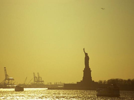 Statue Of Liberty Against A Golden Sky