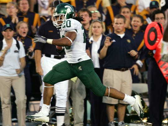 Running back Jason Teague of the Michigan State Spartans