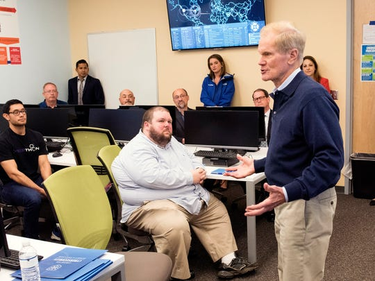 Sen. Bill Nelson talks on Friday, May 5, 2017, with a group of cybersecurity students and faculty at the University of West Florida during at tour  of the battle lab at the university's Center for Cybersecurity.
