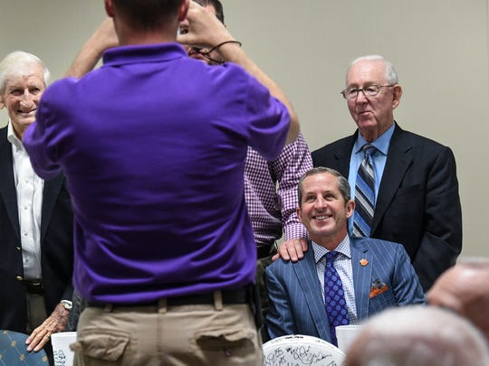 Mark Richardson, right, co-owner of the Carolina Panthers and board member at Clemson University, poses with Bill Brissey, right, before speaking at the Anderson Touchdown Club in the Anderson County Library in Anderson last month.