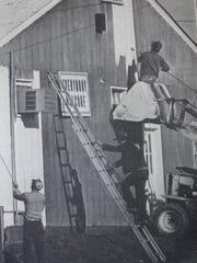 These Morganfield Southern States employees found they could paint the firm's large warehouse and office building a lot quicker if they shared the work with each other on the job in 1983.